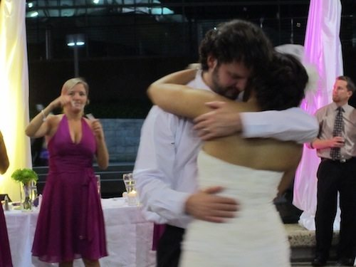 As the bride and groom danced, his sister blew bubbles at them. How sweet is that?