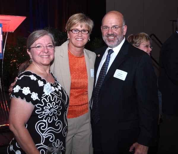 Warlick with UT President Joseph DiPietro and his wife, Deb
