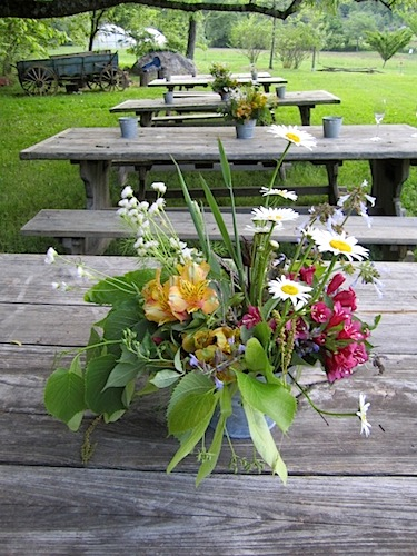 i thought the flowers on the picnic tables were lovely.