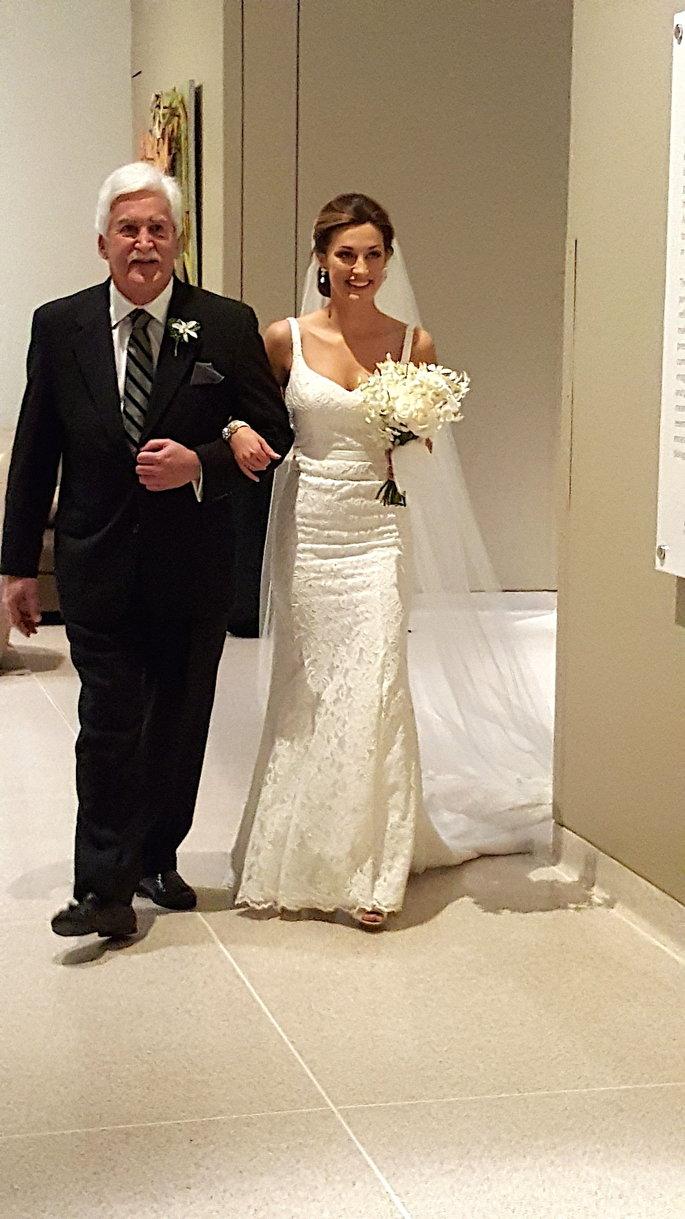 Here comes the bride, with her father, David Robinson.