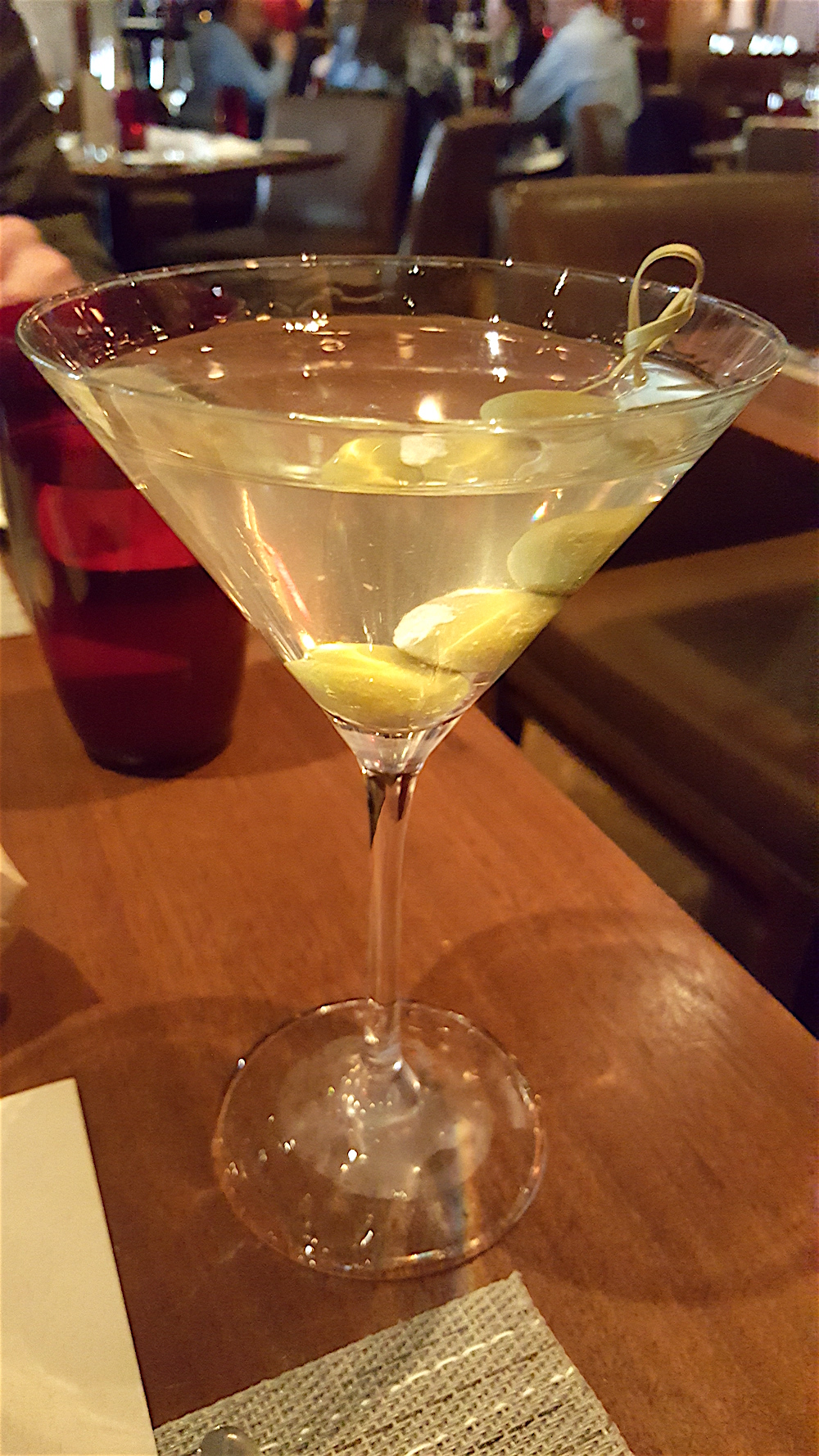 My first order of business. Vodka martini, dirty, up, with blue cheese olives. Yes, please.