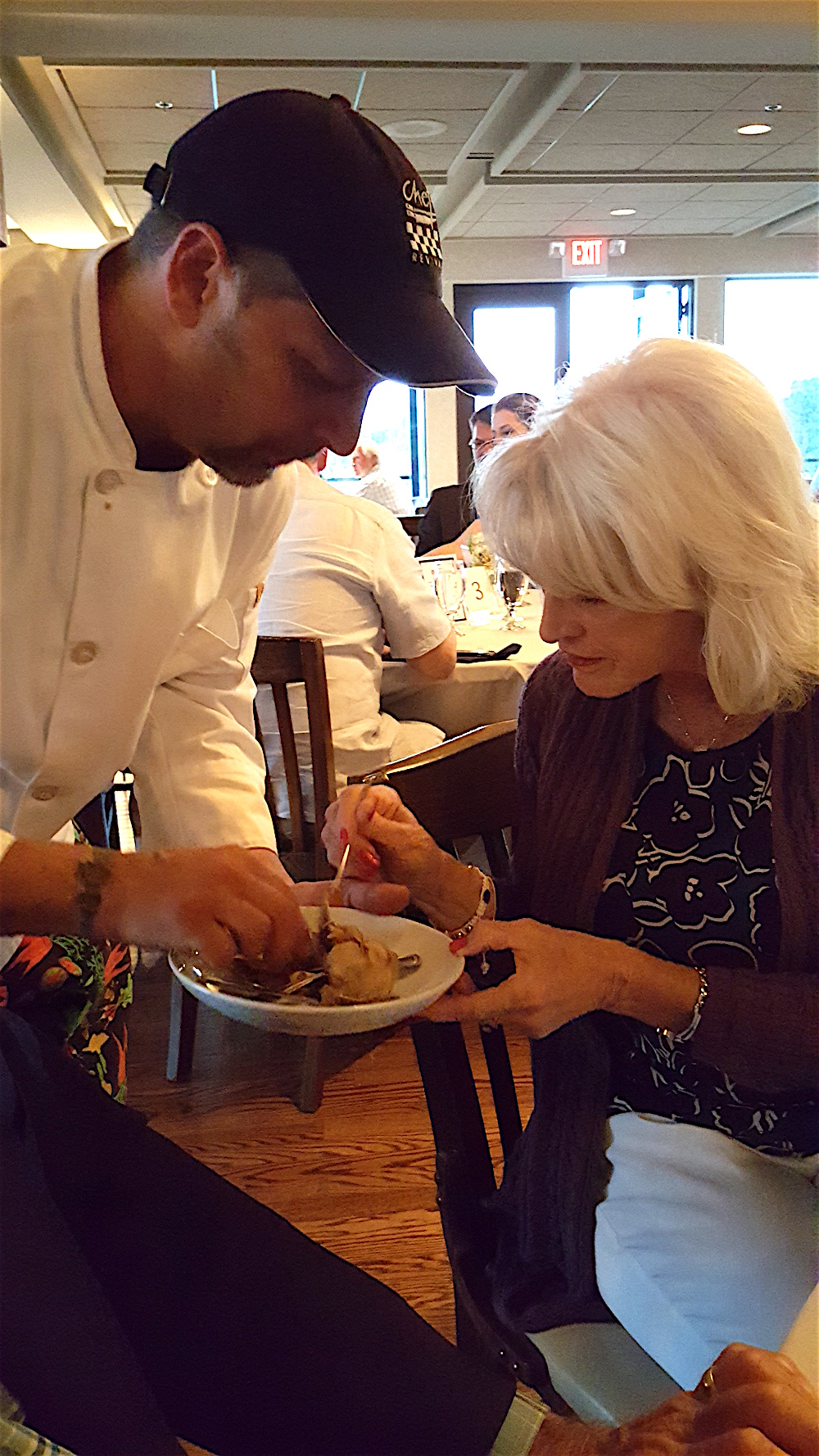 The chef had us all try some black garlic that he had roasted for 30 days at 110 degrees, if you can believe! Here, Judy Collins Griess is trying it out.