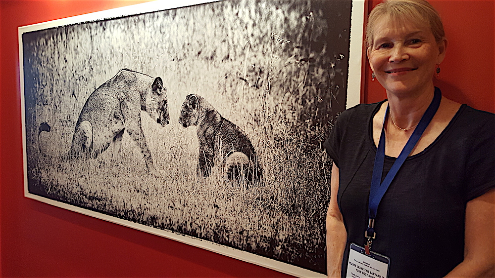 Gayle Buston, who husband's photography fills the walls, showed everyone around.
