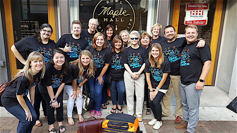 The Moxley Carmichael team in front of Maple Hall, 414 S. Gay Street. Front row, from left, graphic designer Erica Beck, intern Jordan Shipowitz, account executive Savanna Howie, senior account executive Amanda Jennings, CFO Shaun Fulco, writer/editor Maria Cornelius, and Amy Barger, our manager of first impressions. In rear, from left, graphic designer Katrina Roberts, senior web designer John McCulley, president Alan Carmichael, writer Michelle Henry, director of client services Lauren Miller, me, Pam Rhodes who will be joining us shortly as our digital storyteller, creative director Charley Sexton and intern Jake Bruce. Only one mission was our vice president Scott Bird, who was out of town on business.