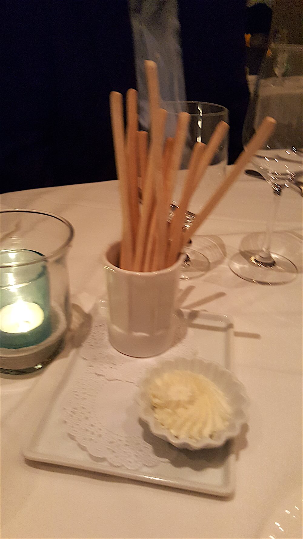 Breadsticks with truffle butter are waiting for you at the table.